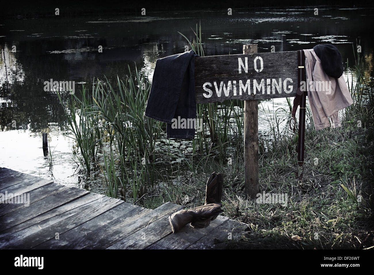 no-swimming-sign-by-a-pond-with-vintage-