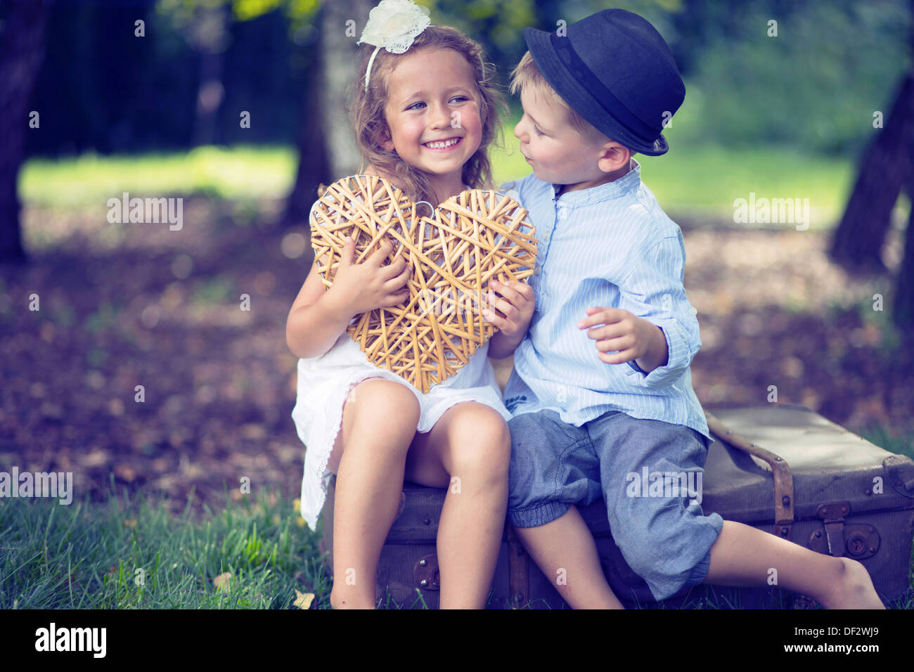 portrait of cute couple of small kids stock photo 60914961 alamy. Black Bedroom Furniture Sets. Home Design Ideas