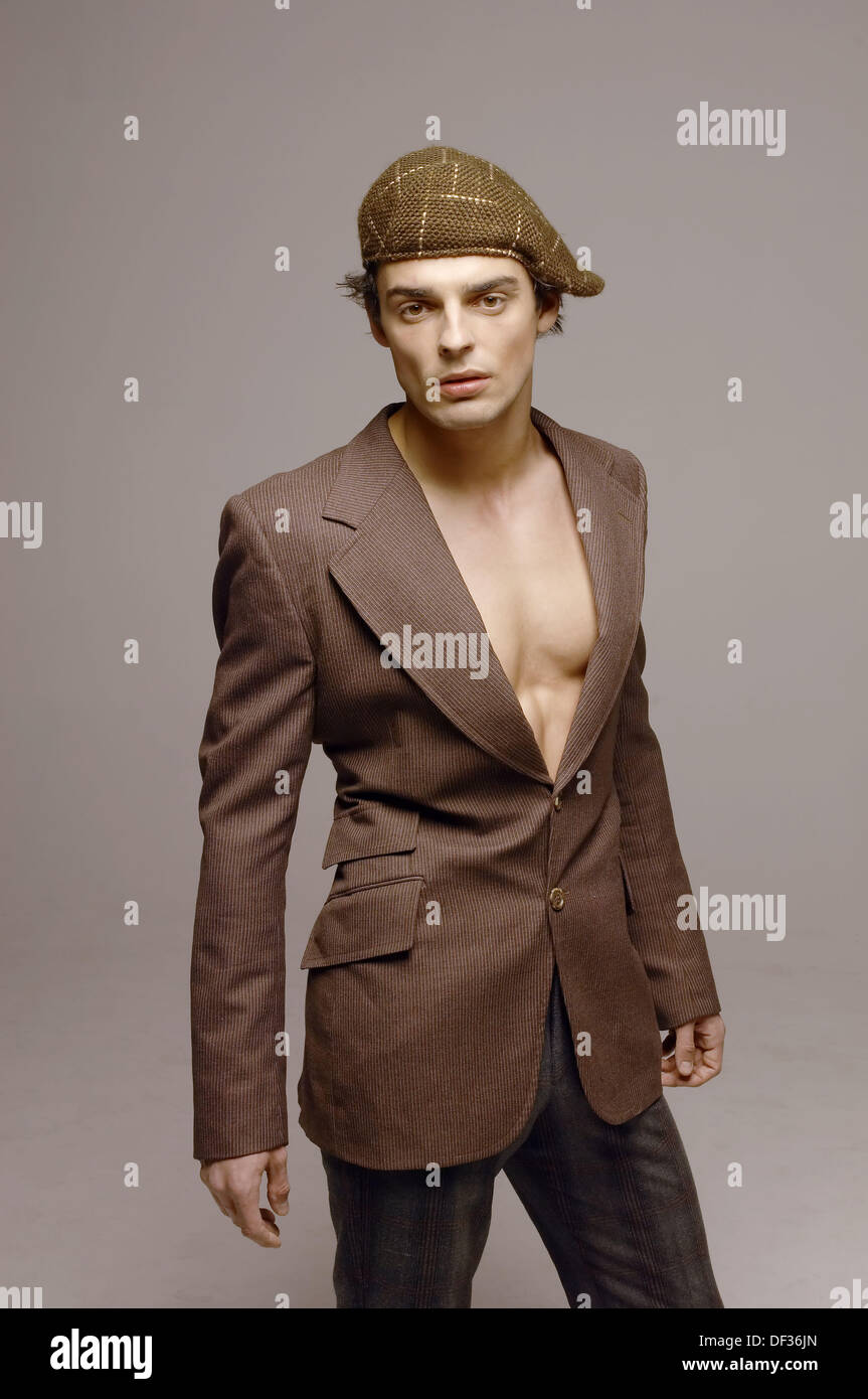young man wearing suit jacket and no shirt Stock Photo, Royalty ...