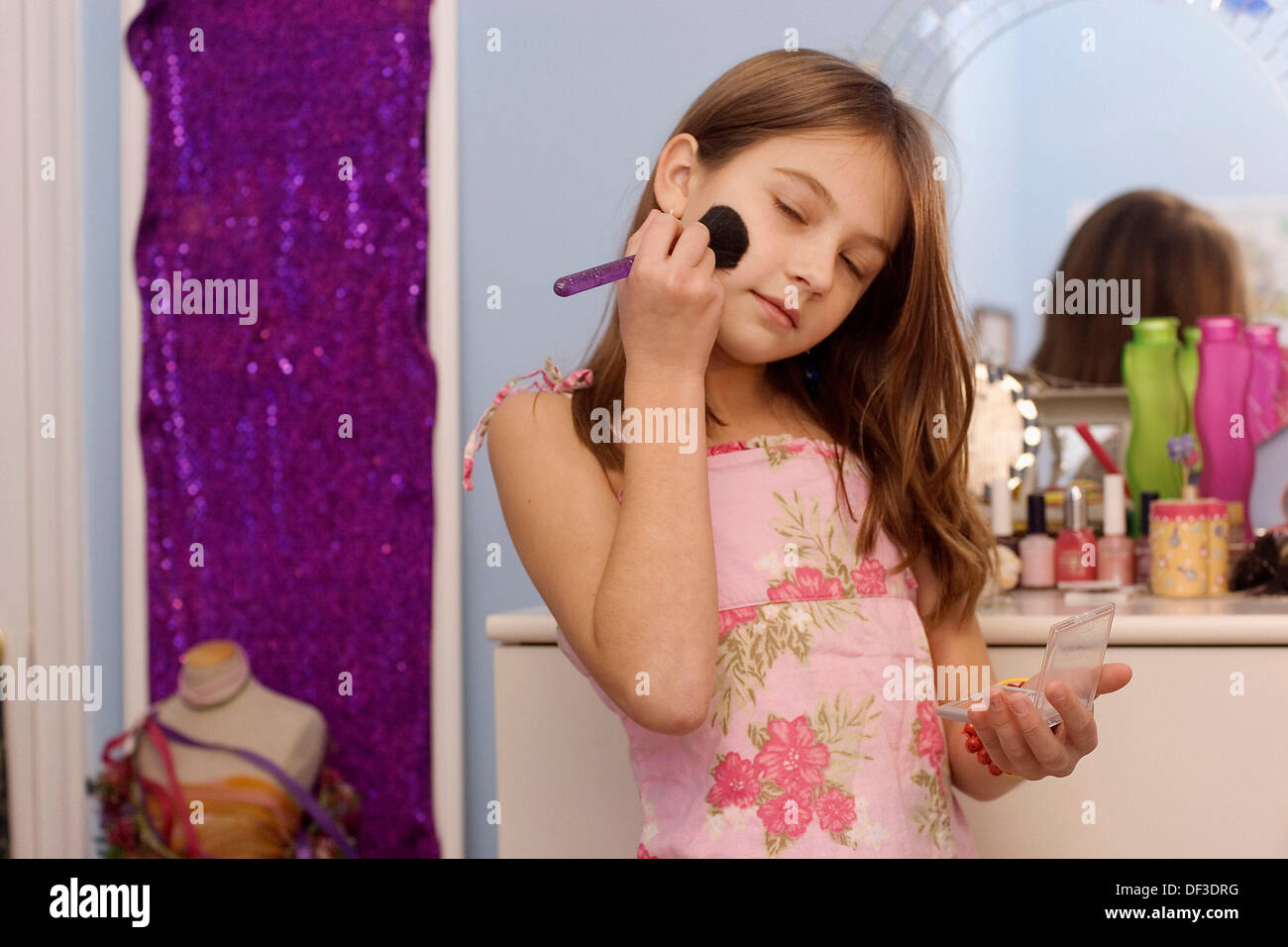 10 Year Old Girl Playing With Make Up In Her Room Stock