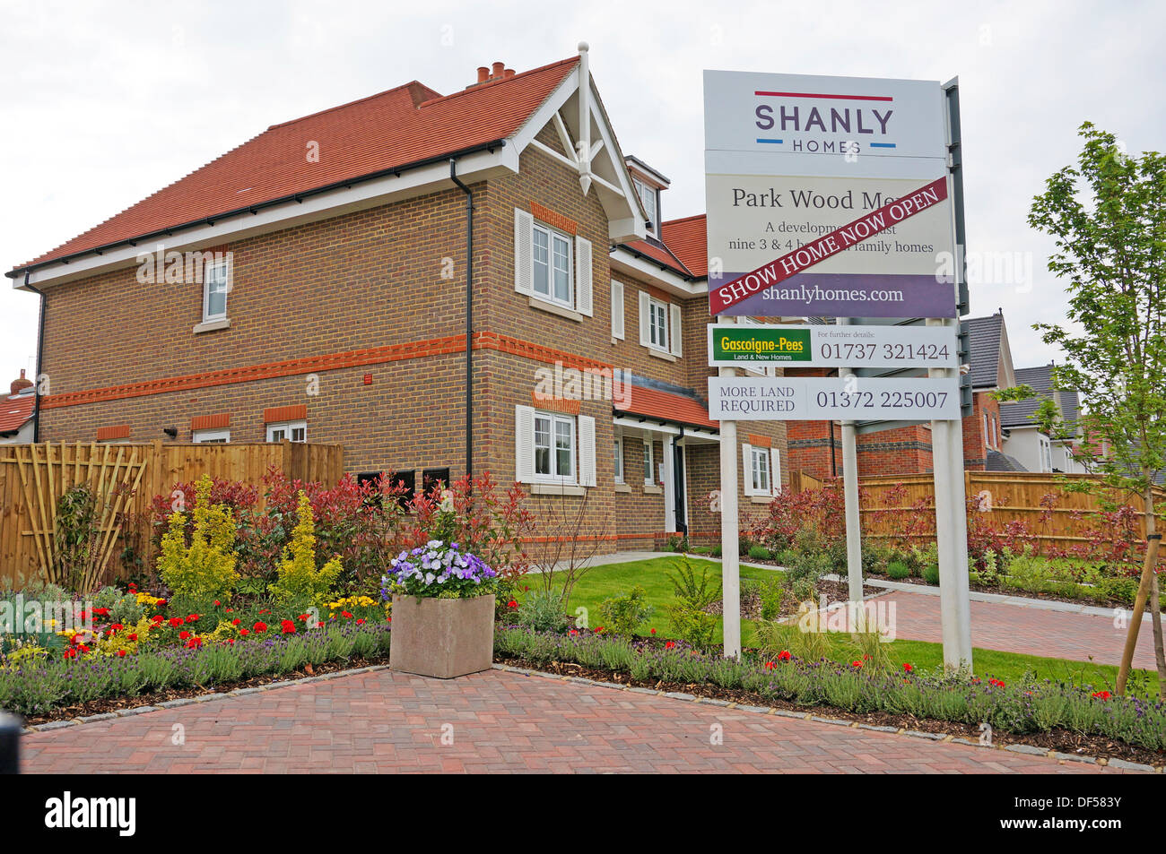 New houses for sale with developer 39 s sale board outside for New homes for sale