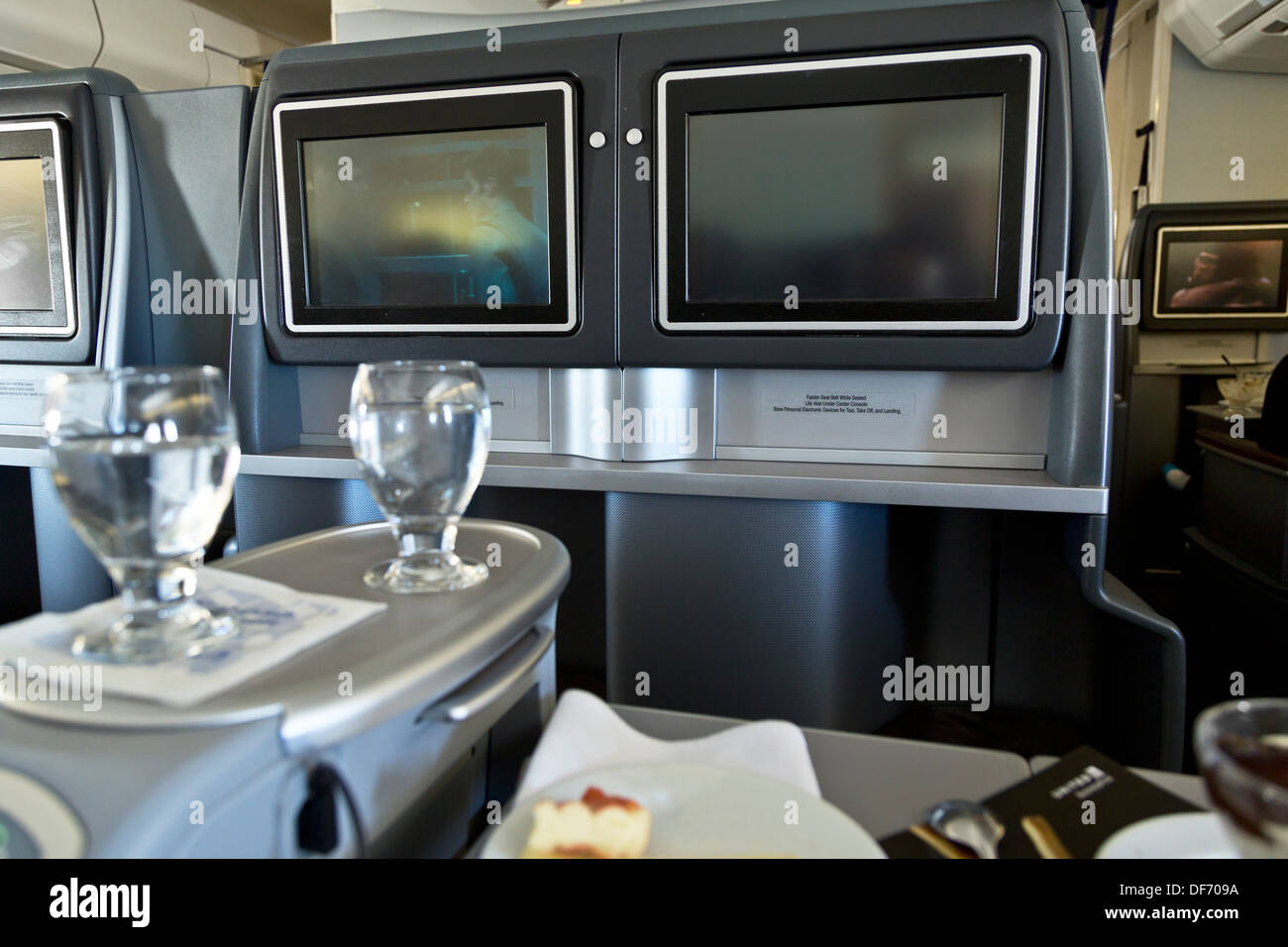 Car interior entertainment - Stock Photo United Airlines Business Class Interior Plane Seats Entertainment Units Drinks Glasses