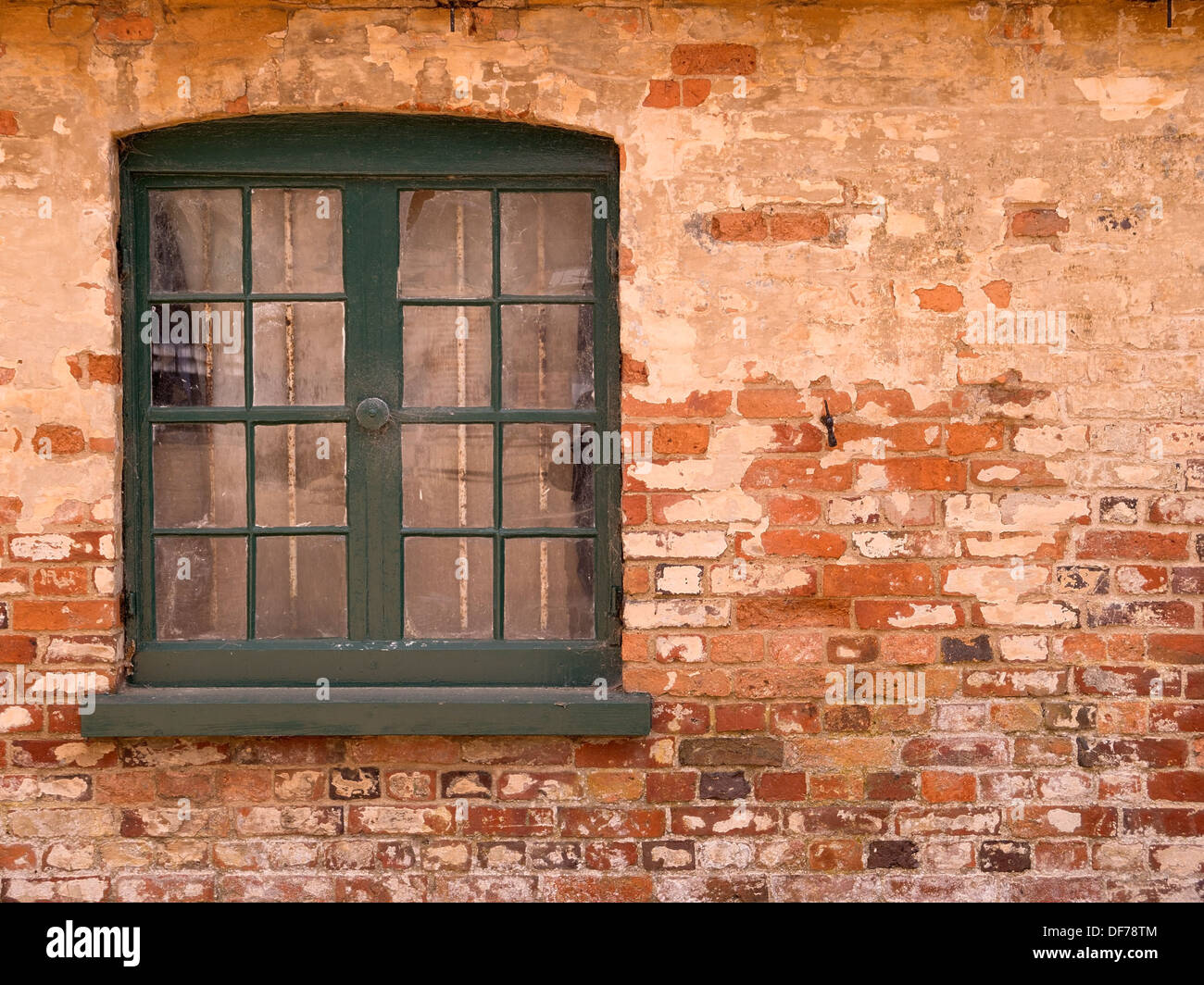 Old wooden window with green painted frame set in old red brick wall stock photo royalty free - Painted brick exterior pictures set ...