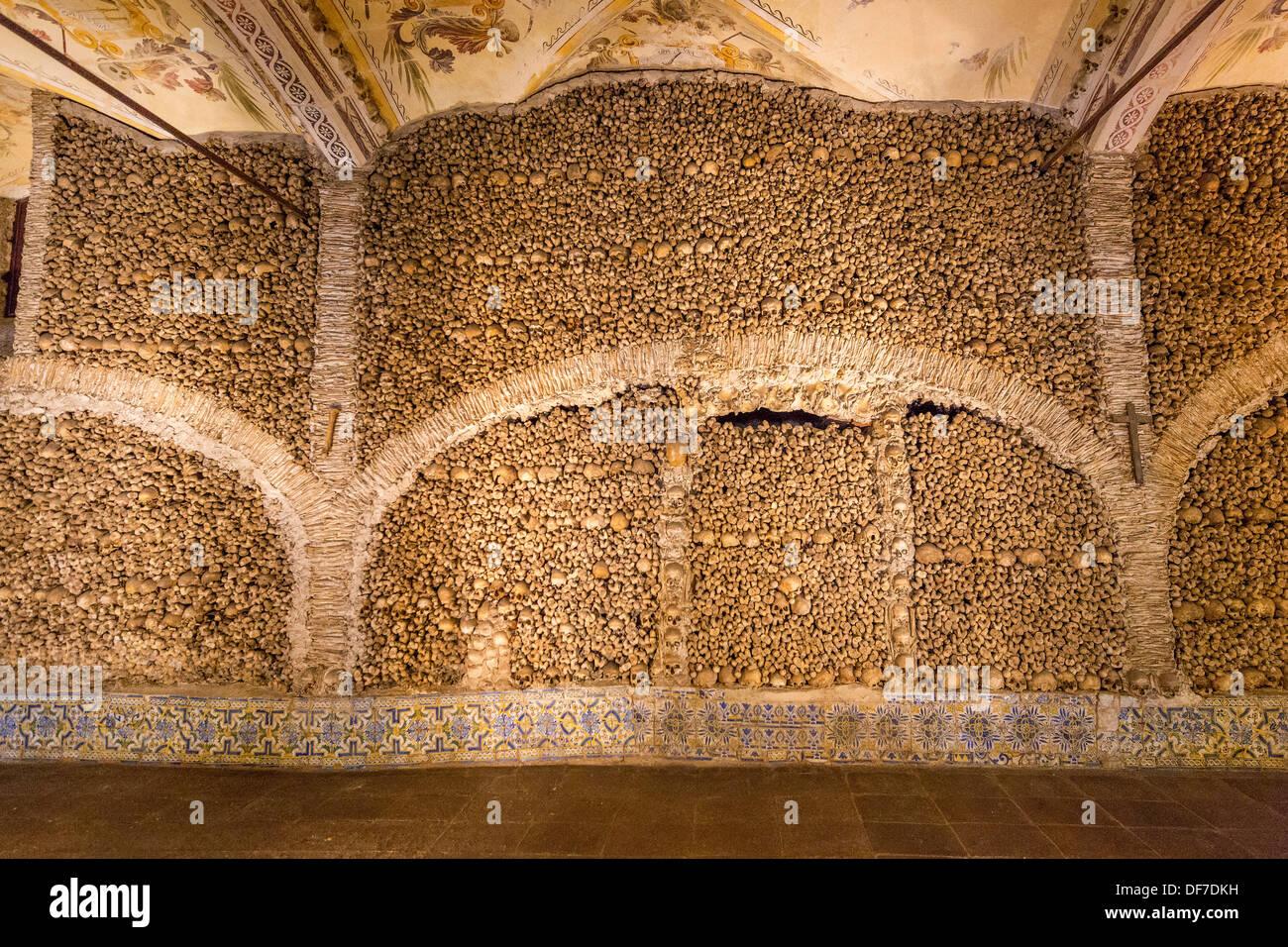 Stacked bones and skulls in the ossuary, Capela dos ossos ...