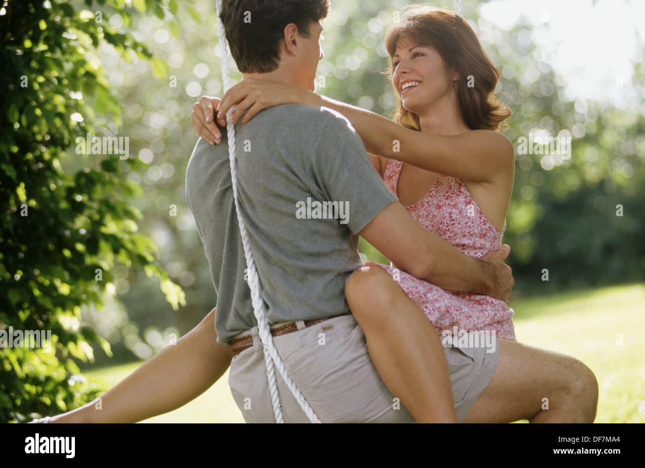 couple in love on a swing Stock Photo, Royalty Free Image ...
