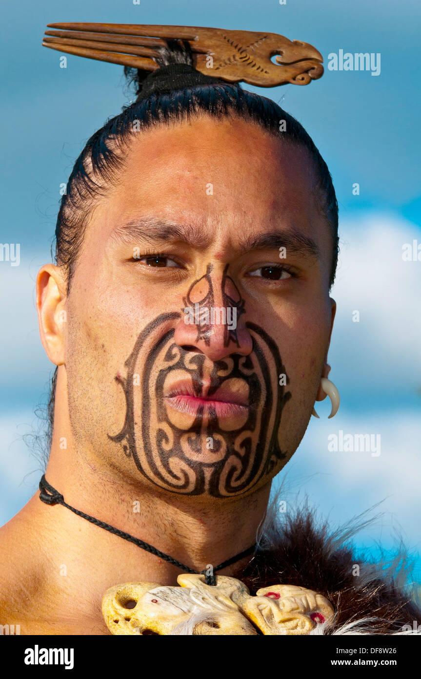 a maori warrior with a ta moko facial tattoo performs a war haka stock photo royalty free image. Black Bedroom Furniture Sets. Home Design Ideas