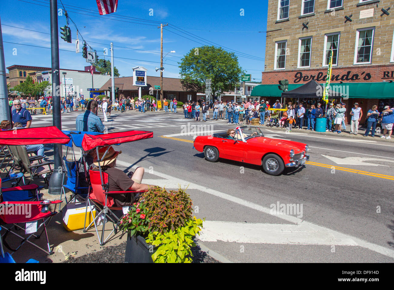 Vintage Race Cars Driving Though Downtown Watkins Glen During The