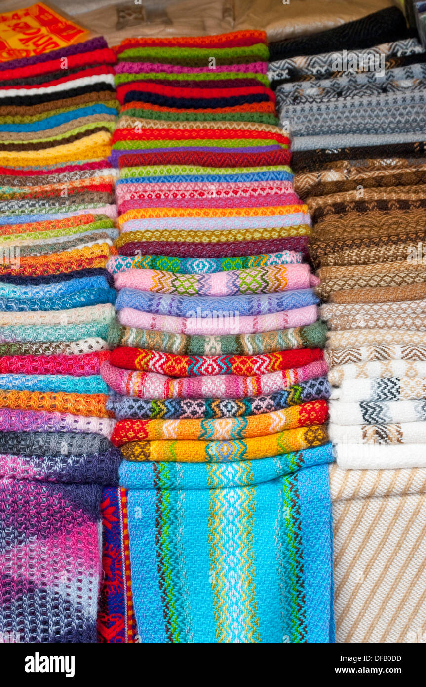closeup of colorful blankets and textiles in the street markets of  - closeup of colorful blankets and textiles in the street markets of pisacurubamba valley peru south america
