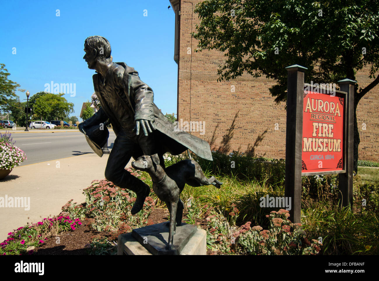 statue of a firefighter and fire safety dog at the aurora regional