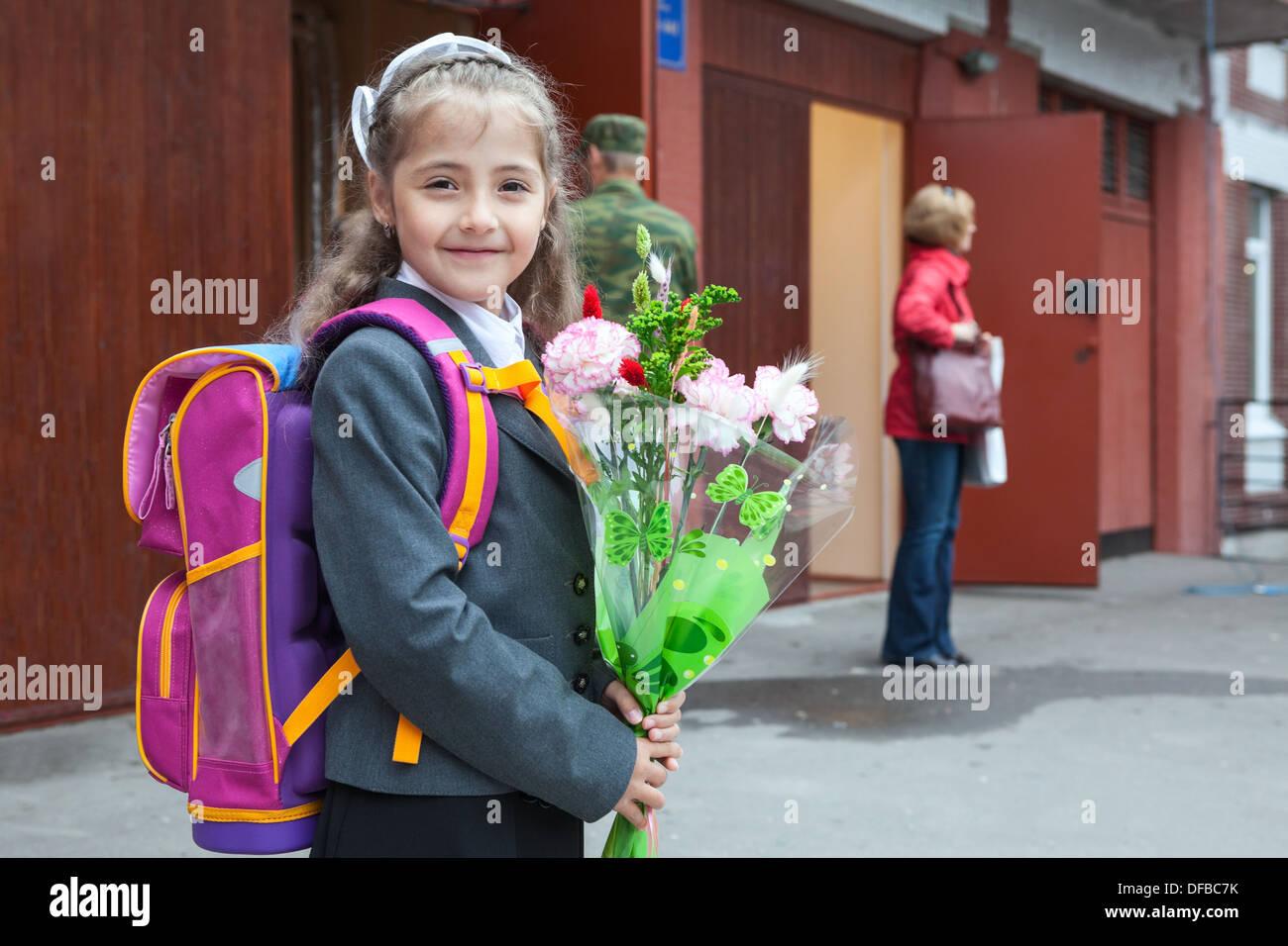 russian schoolgirl Russian schoolgirl with flowers in hands and schoolbag on the back going  back to school in September, 1, Russia