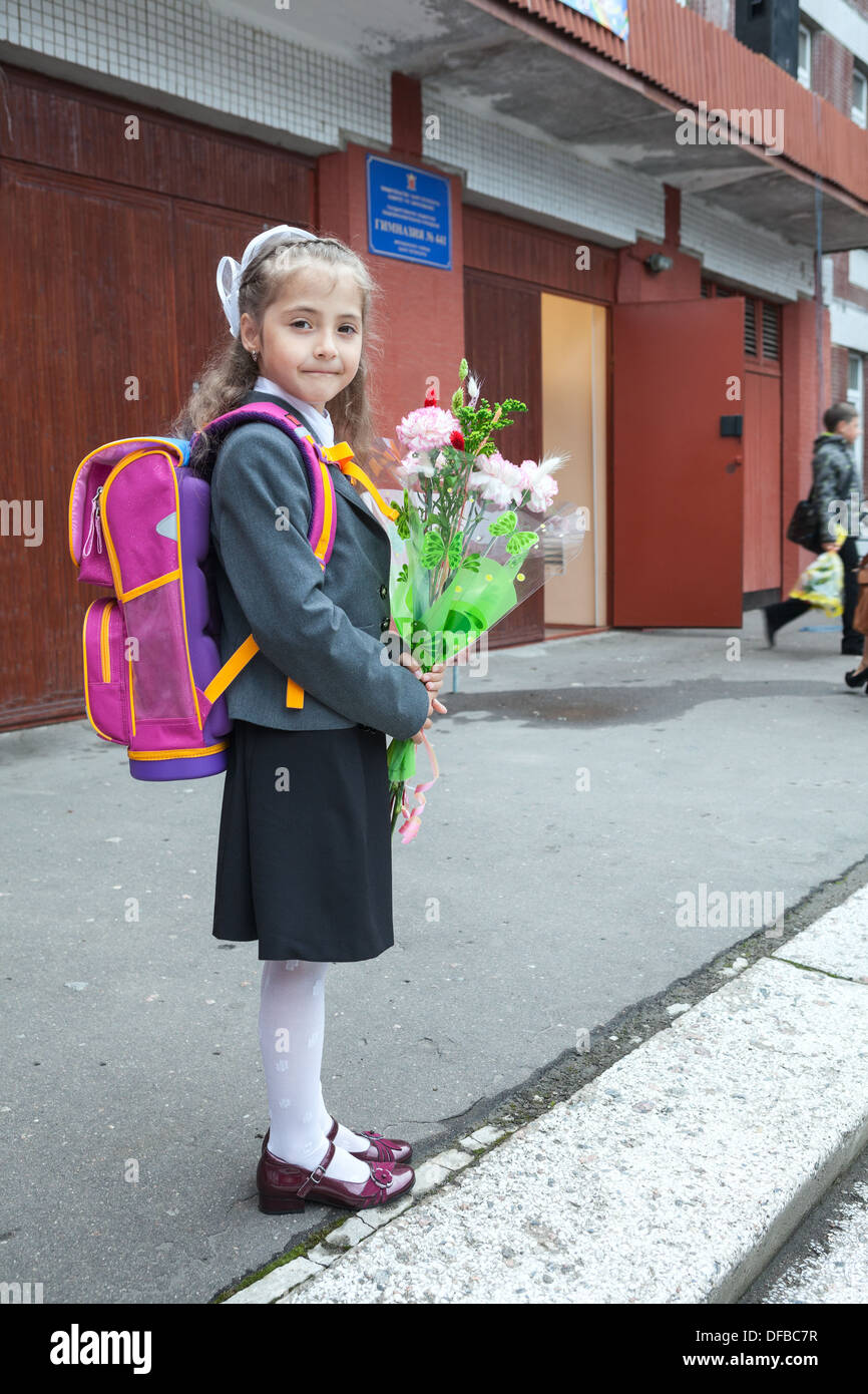 russian schoolgirl Russian small schoolgirl with flowers in hands and schoolbag on the back  going back to school in September, 1, Russia