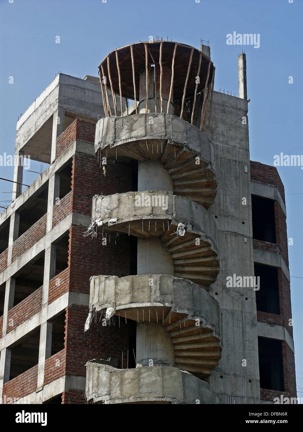 Structure of a building under construction with curved for Construct a house online