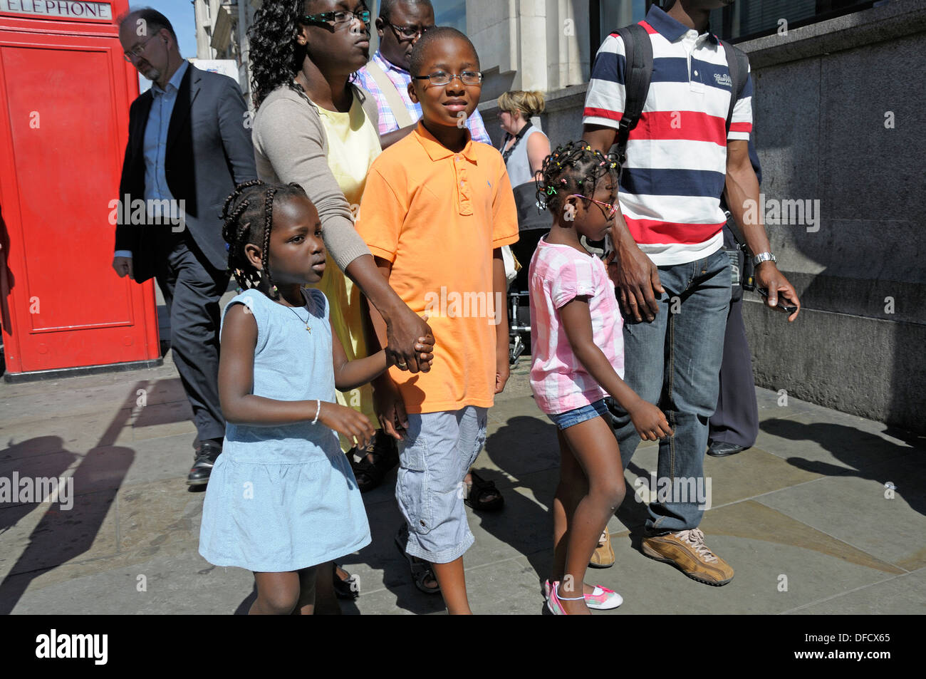 Young Black Family Walking Down Whitehall