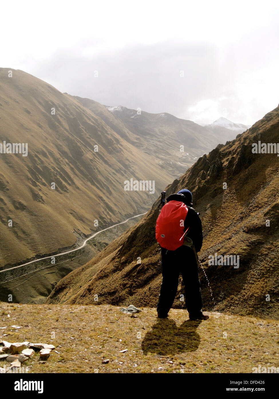Mountain living near cusco peru royalty free stock photo - A Man Peeing While Out Walking In The Andes Mountains During A Trek In The Lares Valley Near Cusco Peru