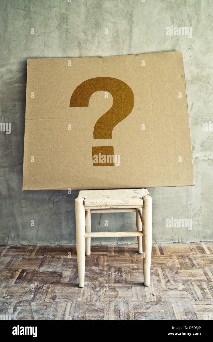 Empty chair in room - Question Mark On Cardboard Left On Empty Chair In Obsolete Room