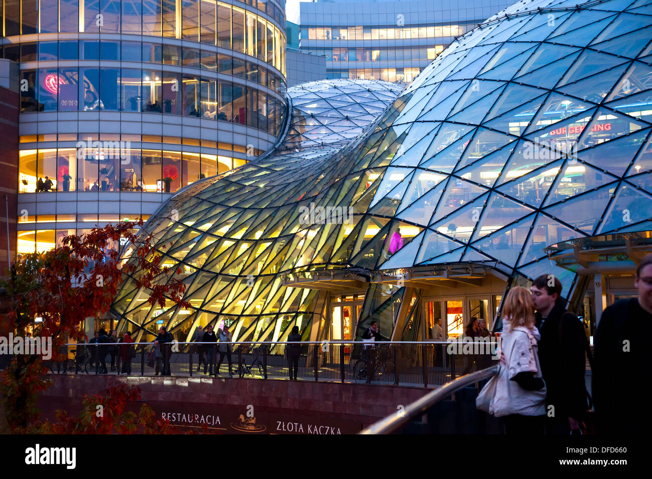 Curvy Glass Roof Of Zlote Tarasy Shopping Mall At Night In Warsaw, Poland