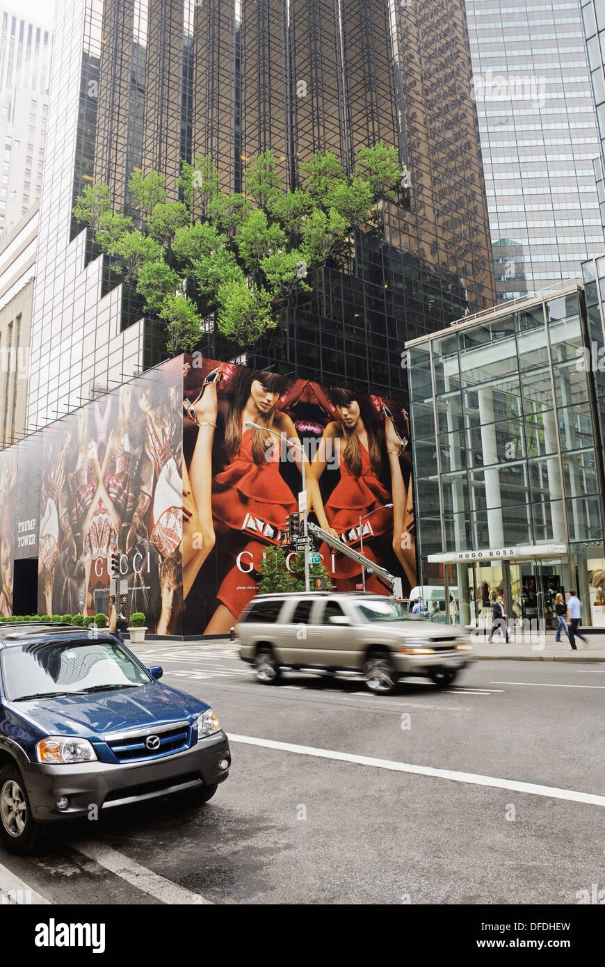 gucci 5th ave. 5th avenue, trump tower with gucci advertising and hugo boss store front, manhattan, new york city, york, usa ave