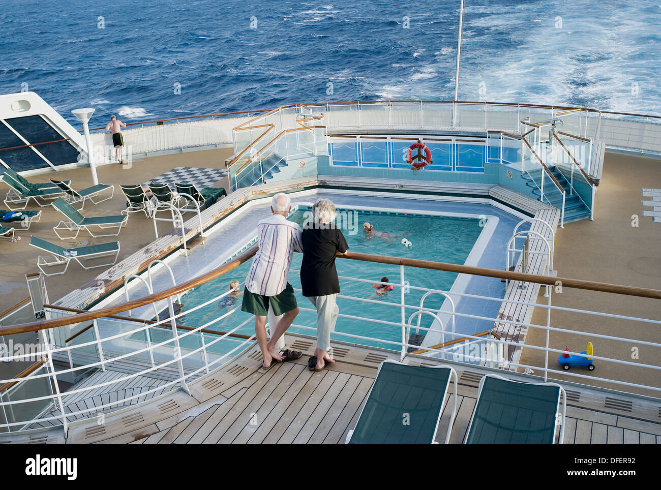 elderly-couple-standing-on-the-deck-of-t
