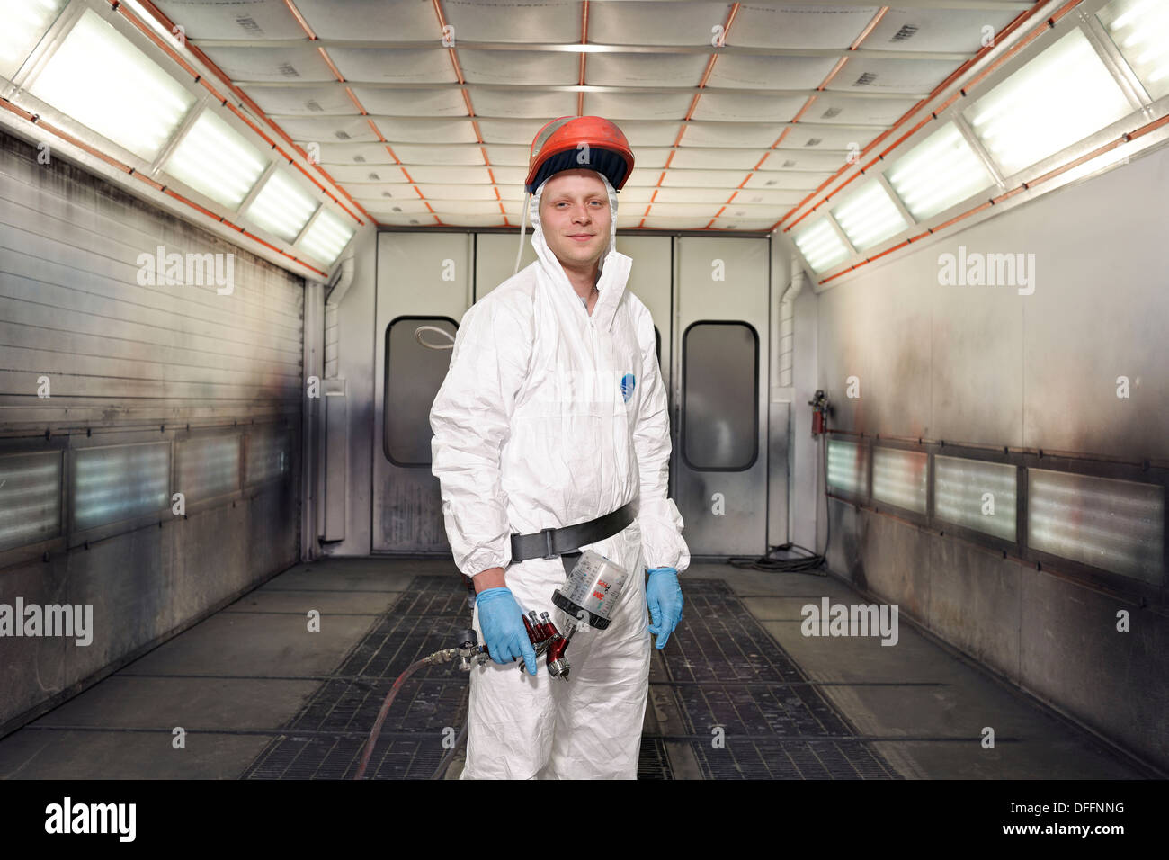 Car Spray Painter In Work Overalls With Spray Paint Gun At An Stock Photo Royalty Free Image