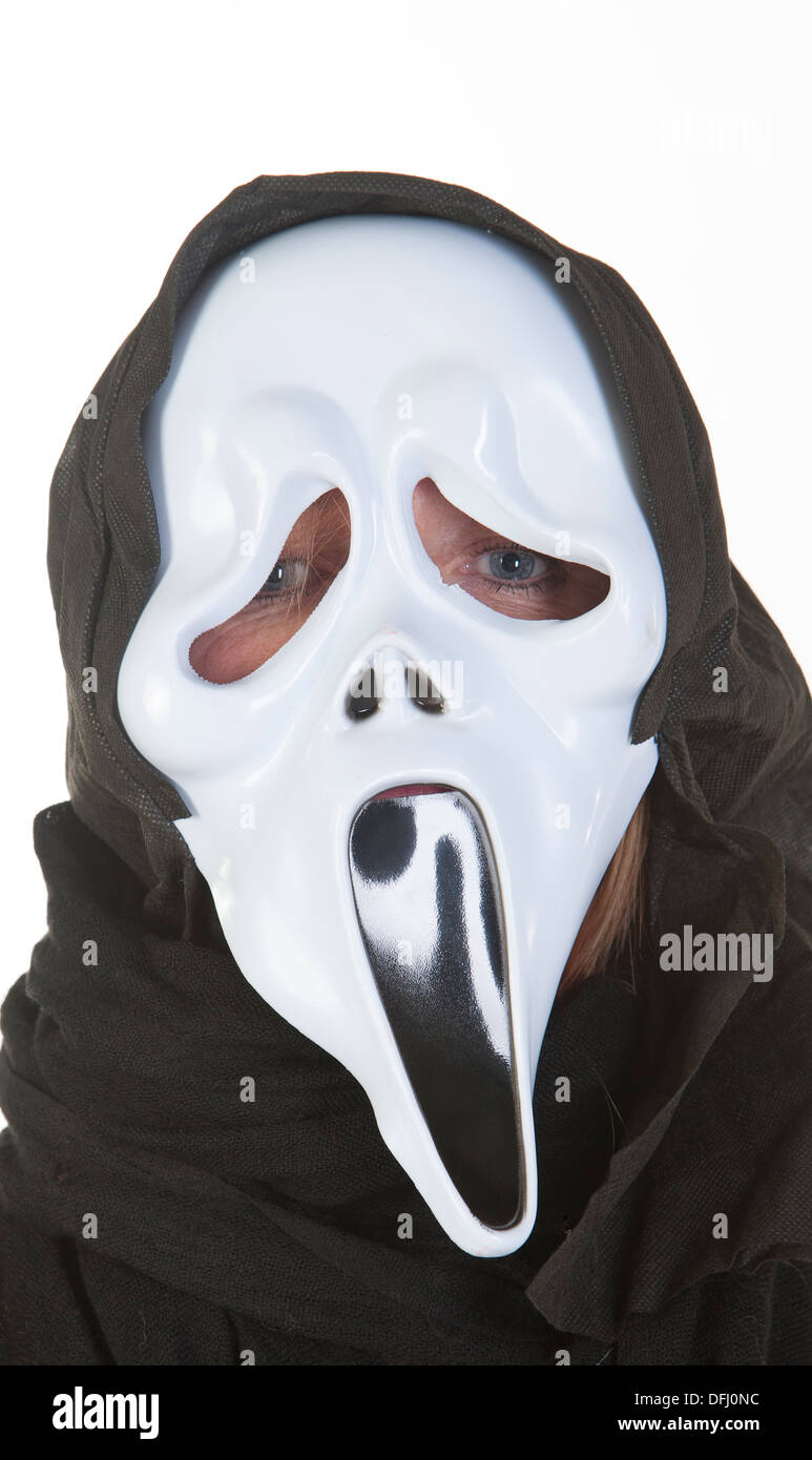 Woman wearing ghost mask at Halloween Stock Photo, Royalty Free ...