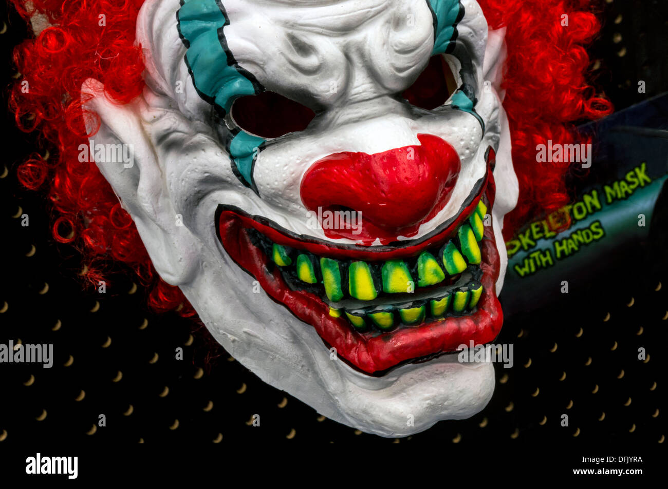 Scary, frightening Halloween clown face mask with red hair and ...