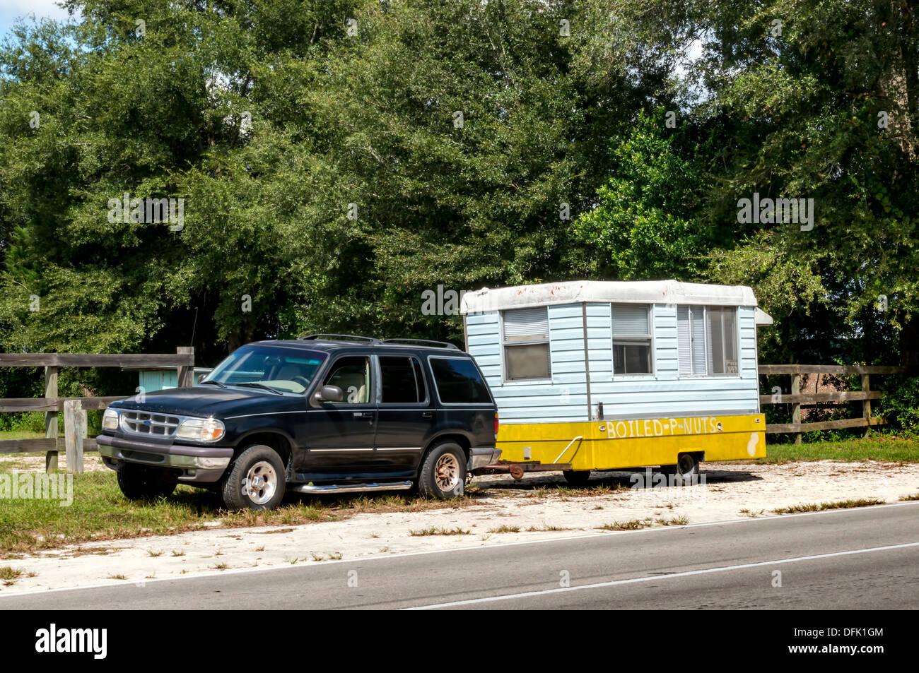 Black Suv Towing Small Trailer A Roadside Boiled Peanut Vendor In