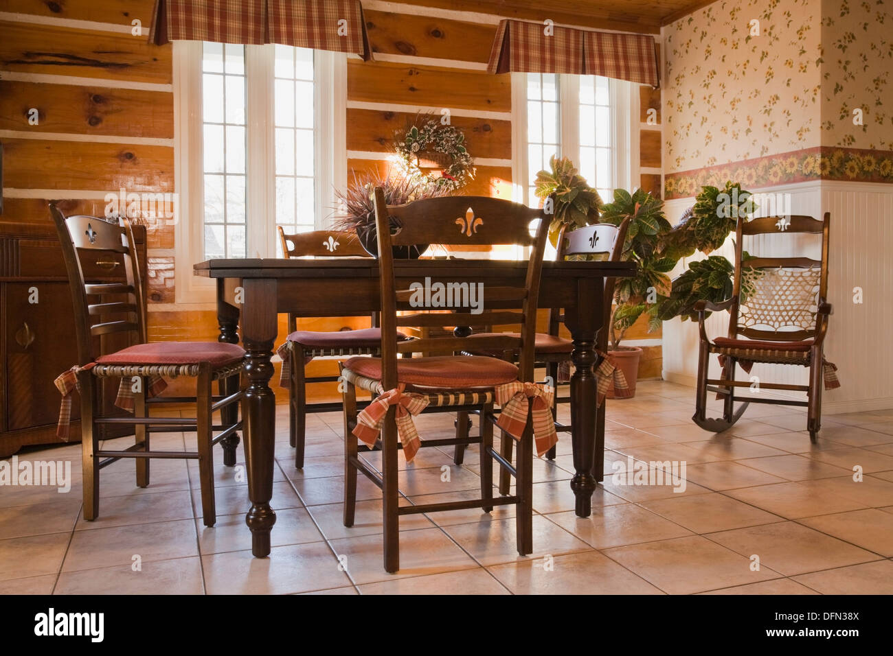 Antique style dining table and chairs in the dining room of a 1978  reproduction of an old Canadiana cottage style log and - Antique Style Dining Table And Chairs In The Dining Room Of A 1978