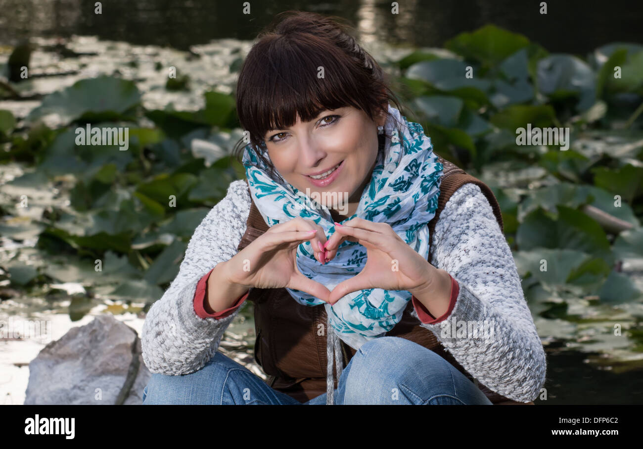 Lovely woman sending love heart by the fall Stock Photo, Royalty ...