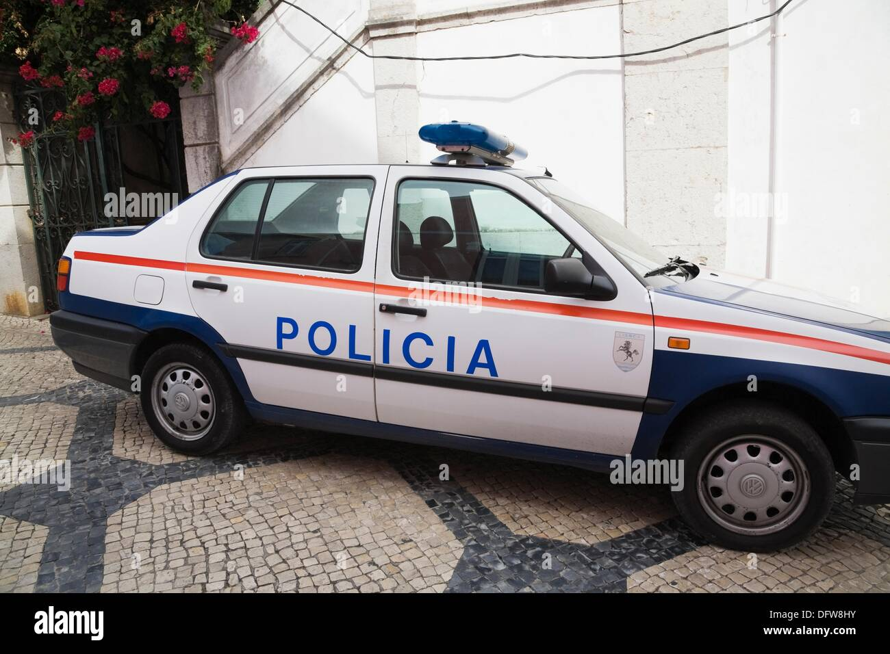 parked police car on a city street in cascais portugal europe stock photo royalty free image. Black Bedroom Furniture Sets. Home Design Ideas