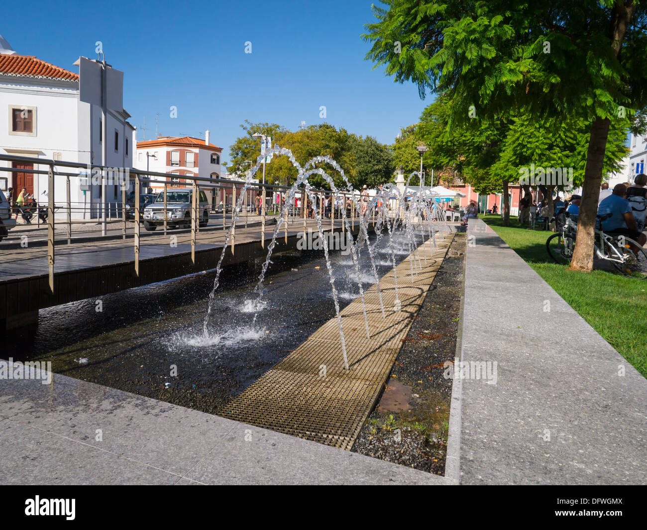Portugal Algarve Loule Town Centre Center Modern Water Fountain Feature  Pedestrian Causeway Walkway Public Space Tree Trees Buildings People Blue  Sky