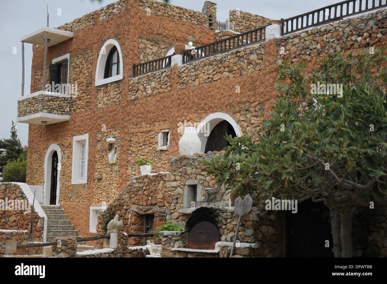 Traditional Greek Houses ancient greek house with a stone staircase and balcony stock photo