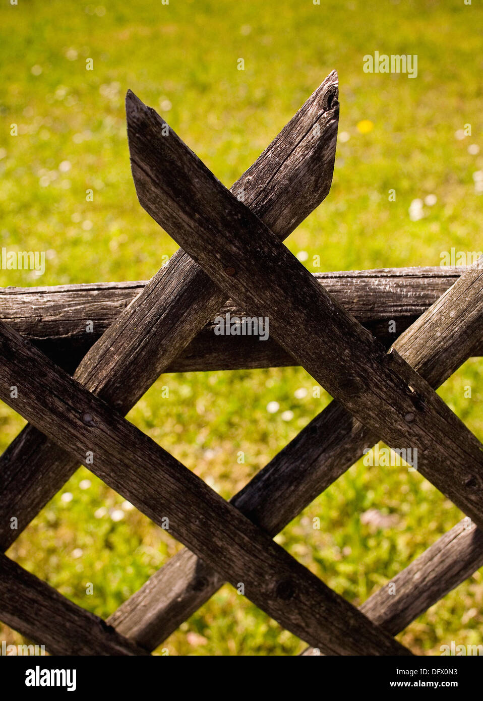 Wood fence with criss cross pattern close up stock photo