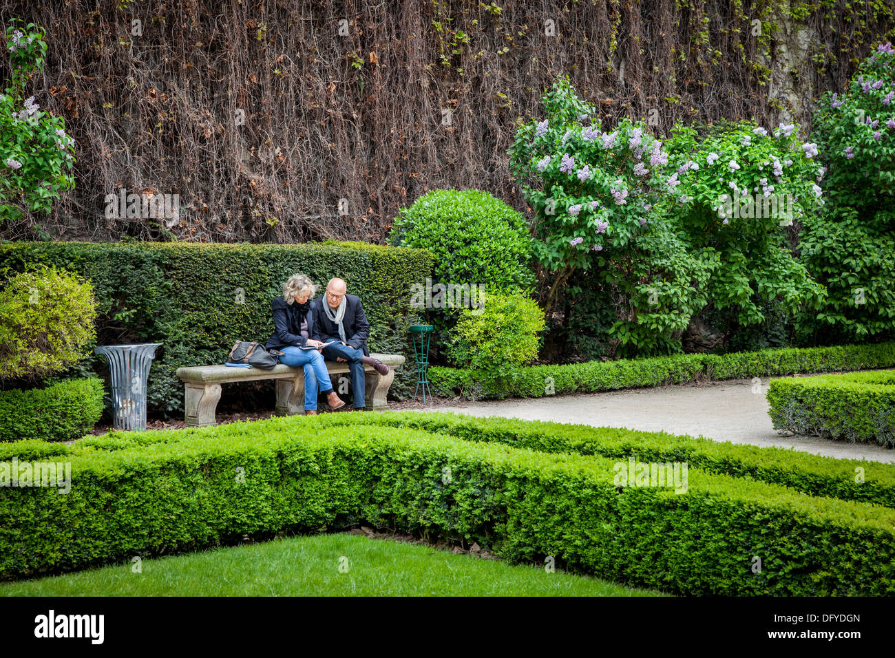Paris Park Bench Couple Sitting On Park Bench Inside