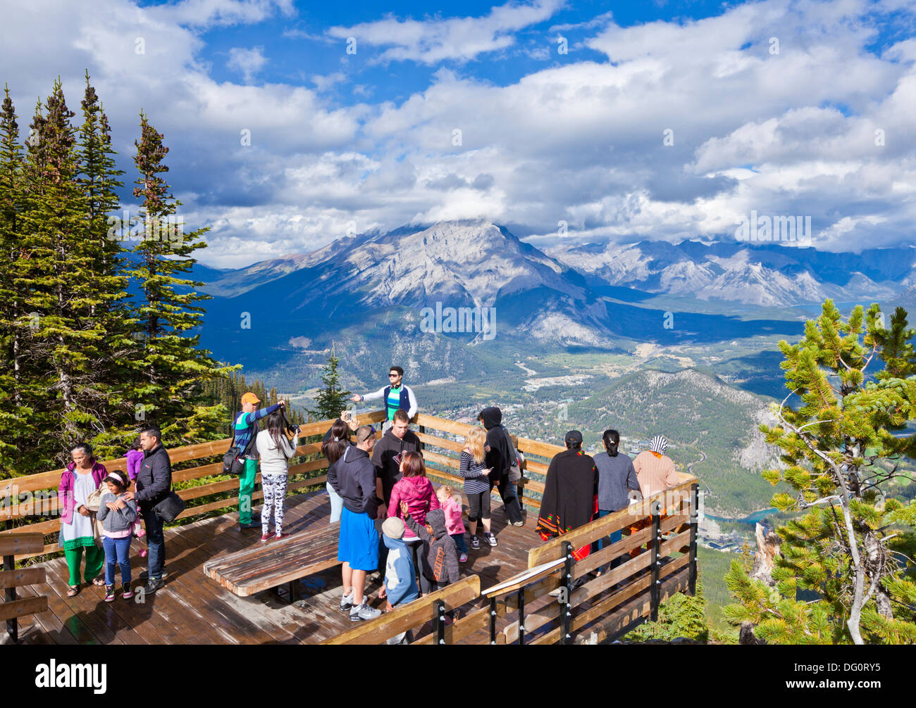 Stock photo visitors on a viewing platform on sulphur mountain summit overlooking banff national park alberta canadian rockies canada