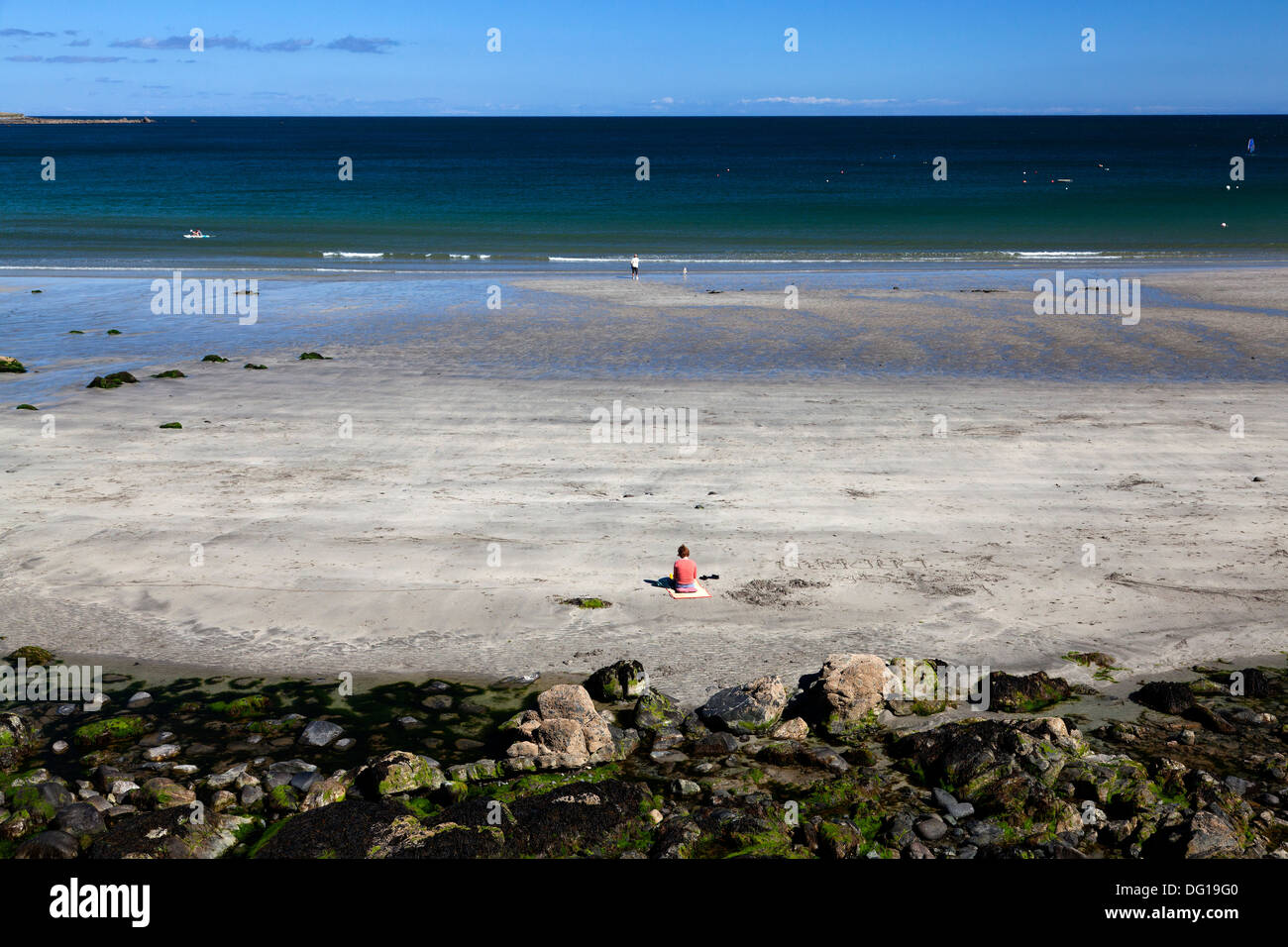solitary-woman-sitting-on-the-beach-cove