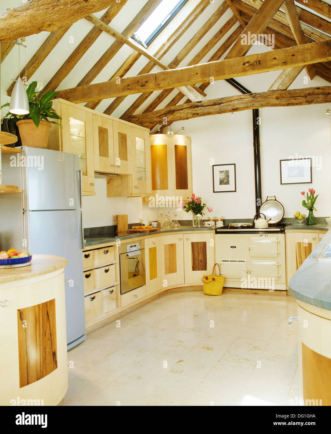 Barn Conversion Kitchens ceramic tiled floor and large refrigerator in contemporary barn