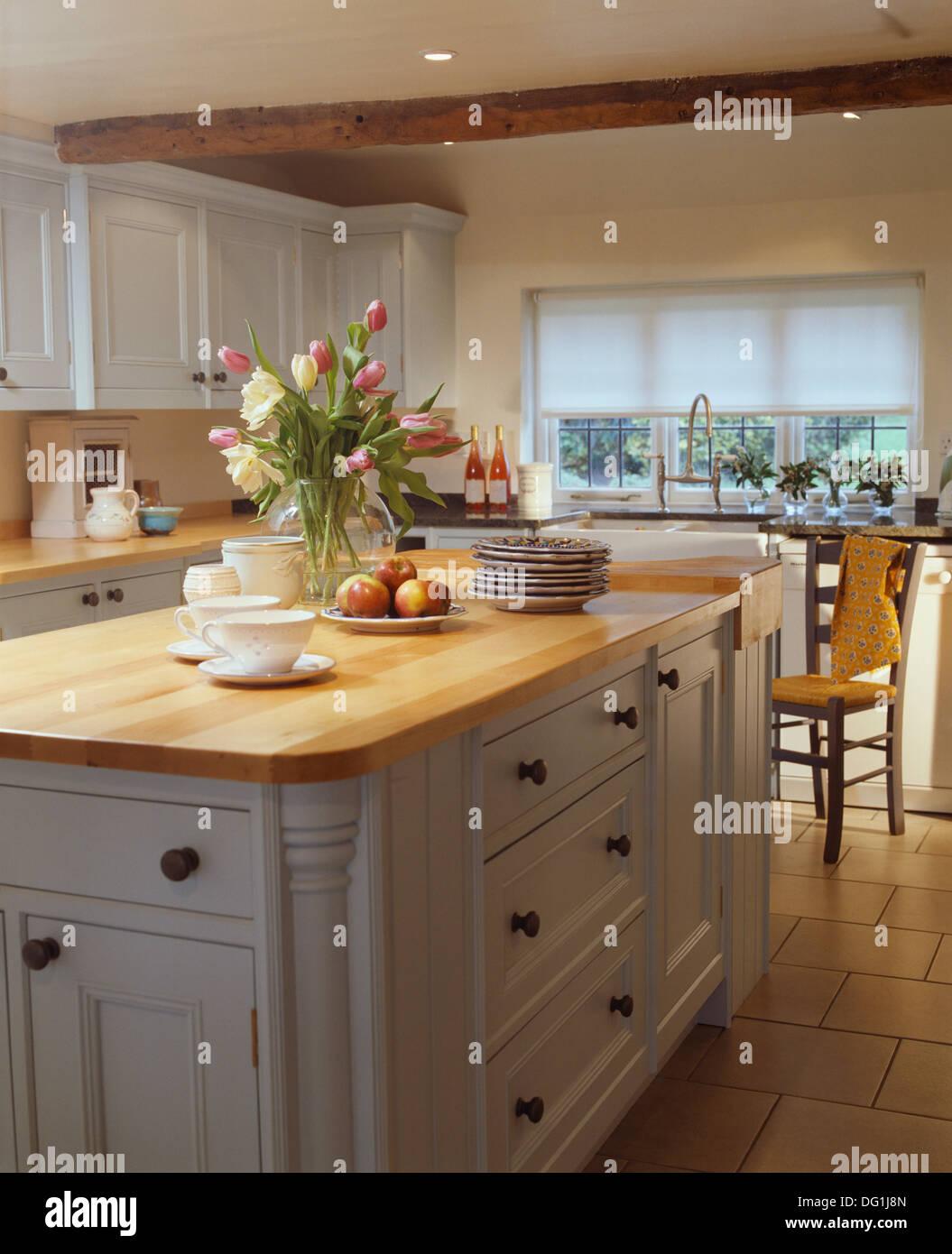 White Kitchen Units Wood Worktop white kitchen units wood worktop vase of tulips on island unit