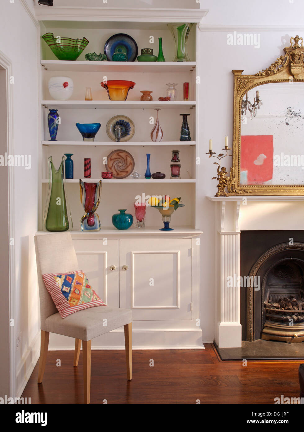 Built In Cabinets Beside Fireplace Collection Of Colorful Sixties Glassware On White Built In Shelves