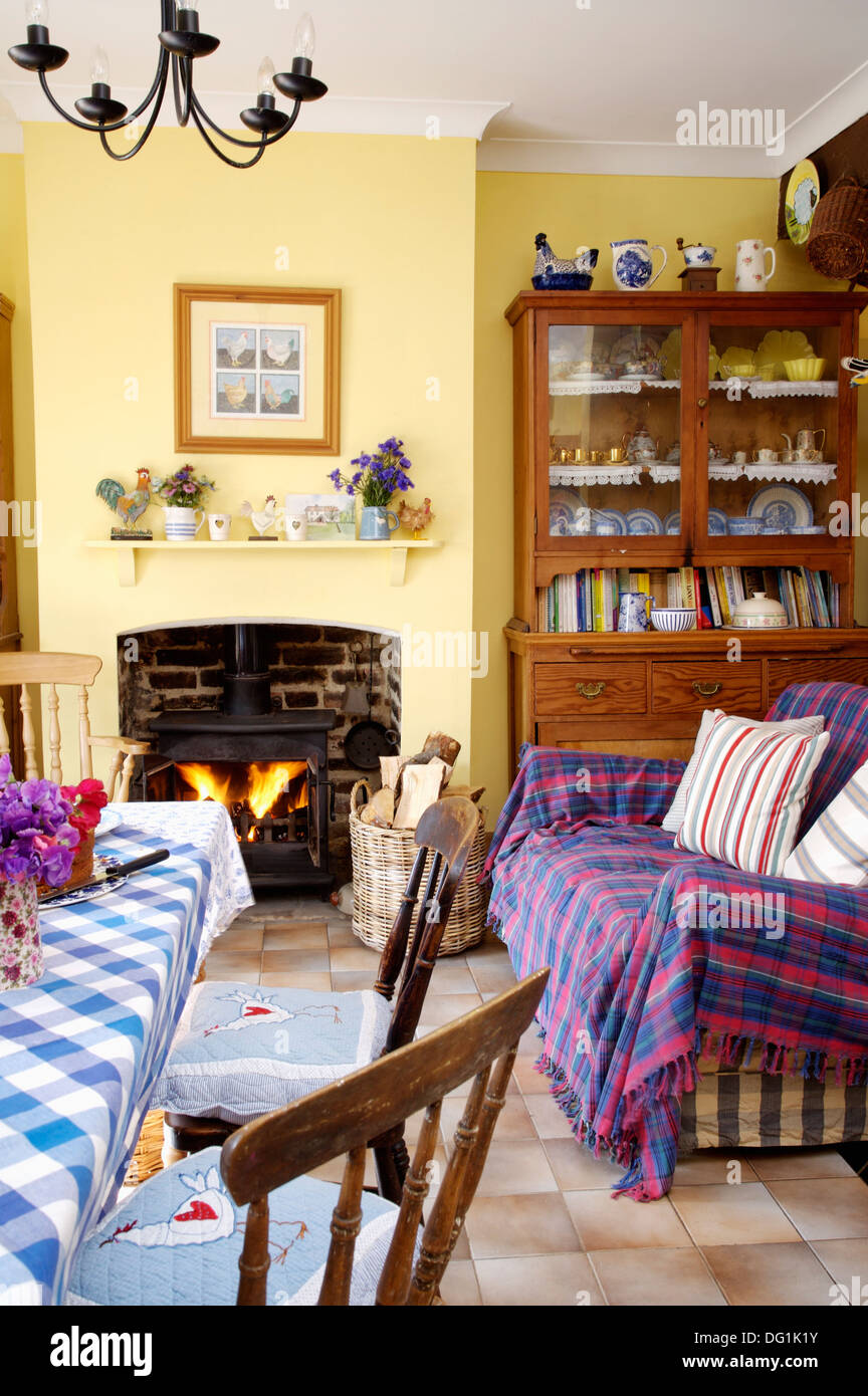 Blue And Red Plaid Throw On Sofa In Country Dining Room With Dresser Beside Fireplace Wood Burning Stove