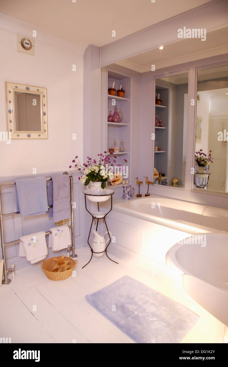 Heated Bathroom Mirrors Flowers In Old French Washstand In Bathroom With Mirror Above Bath