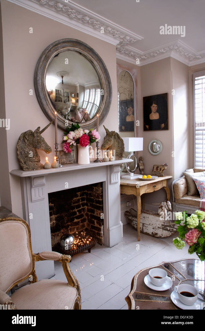 Large circular antique mirror above fireplace with stone for Fireplace mirrors