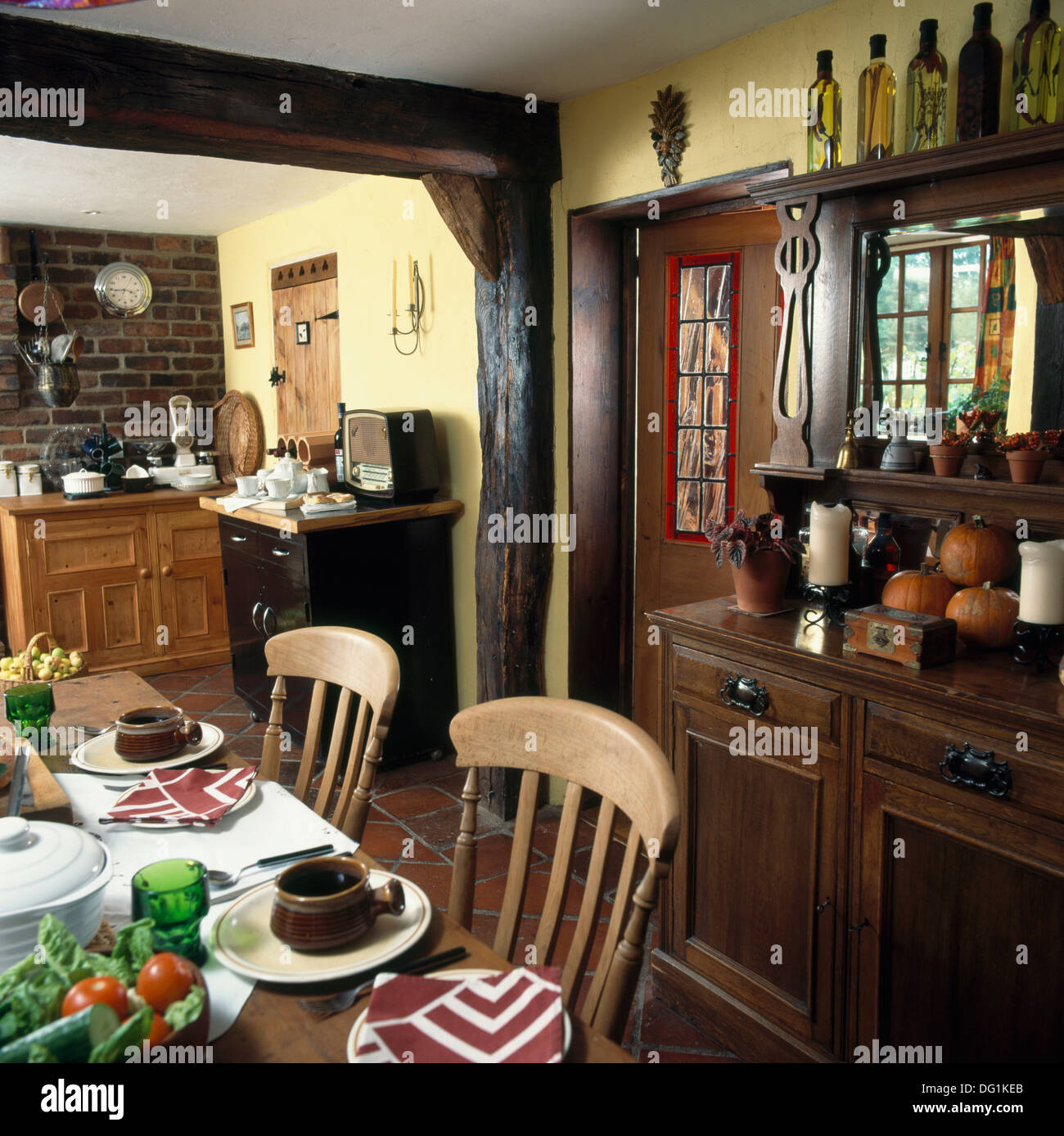 Dark Wood Supporting Beam And Edwardian Style Dresser In Traditional Kitchen Dining Room