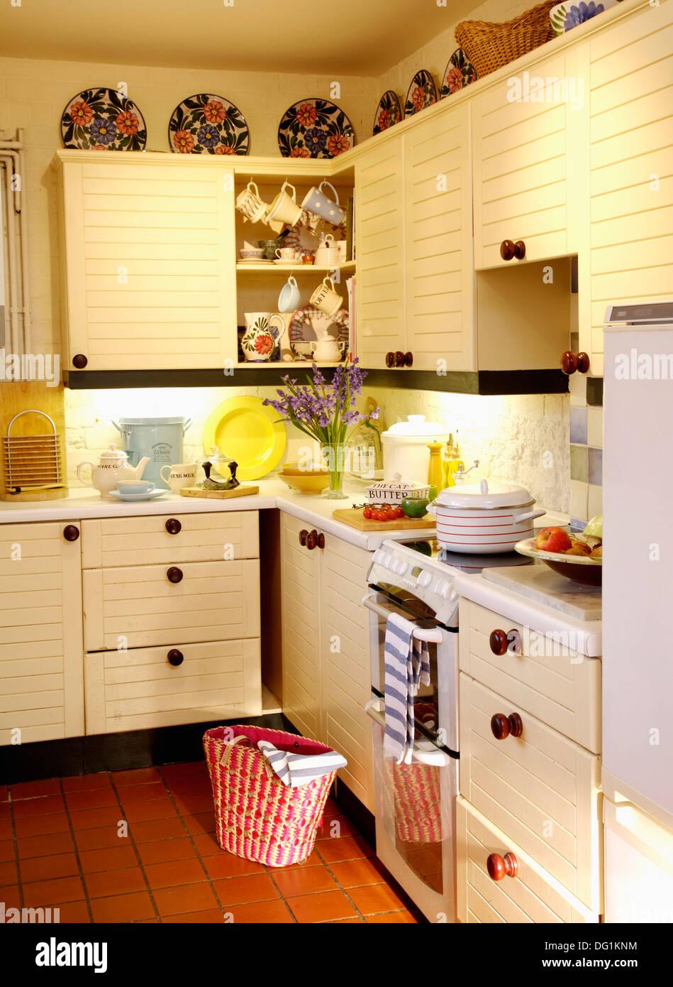 Terracotta Kitchen Floor Cream Cottage Kitchen With Red Basket On Terracotta Tiled Floor