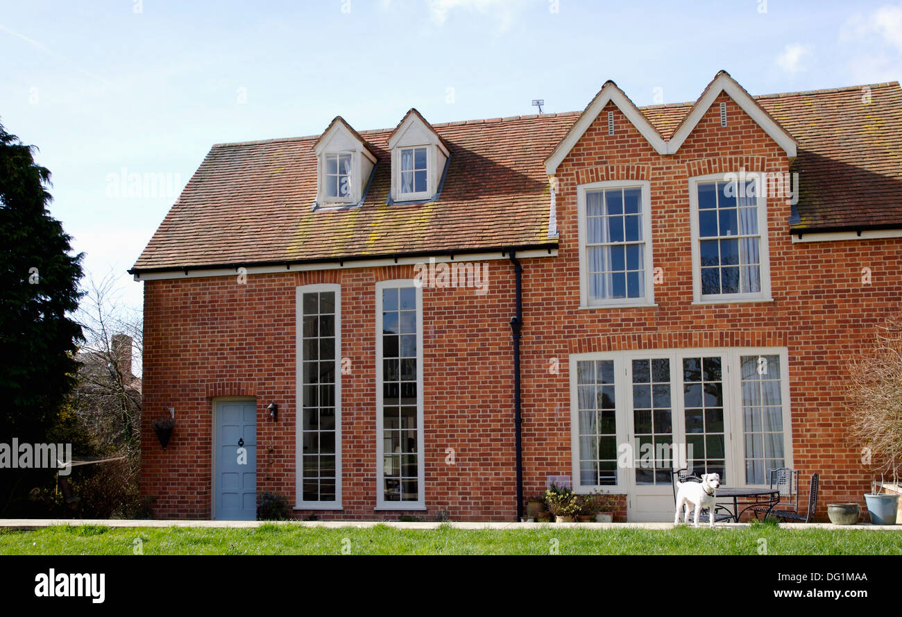 Traditional Brick Country House With Gable Roof And Tall