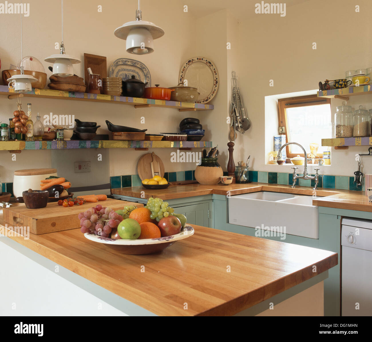 Cherry Wood Worktop In Small Country Kitchen With Belfast Sink And Stock Photo Royalty Free