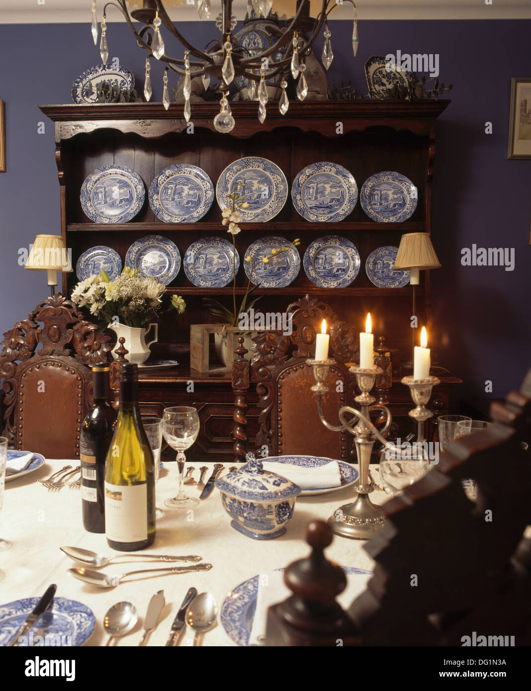 Blue And White Spode Plates On Antique Oak Dresser In Dining Room With Table Set For Dinner Candles Wine