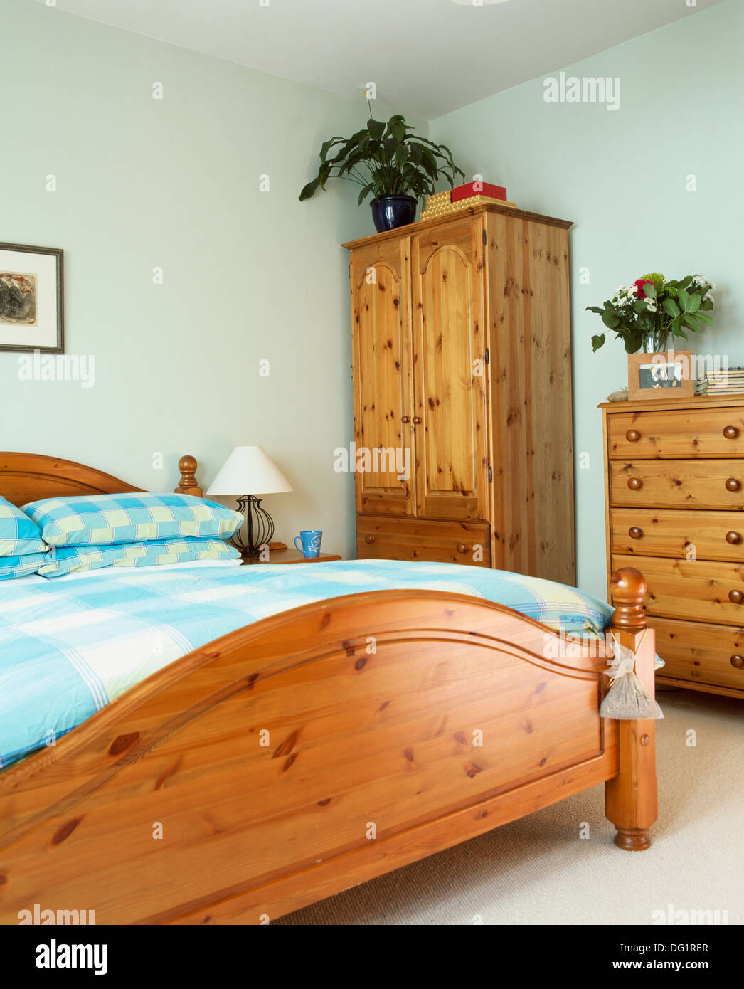 Pine Bedroom Chest Of Drawers Pine Bed With Turquoise Checked Pillows And Duvet In Economy Style