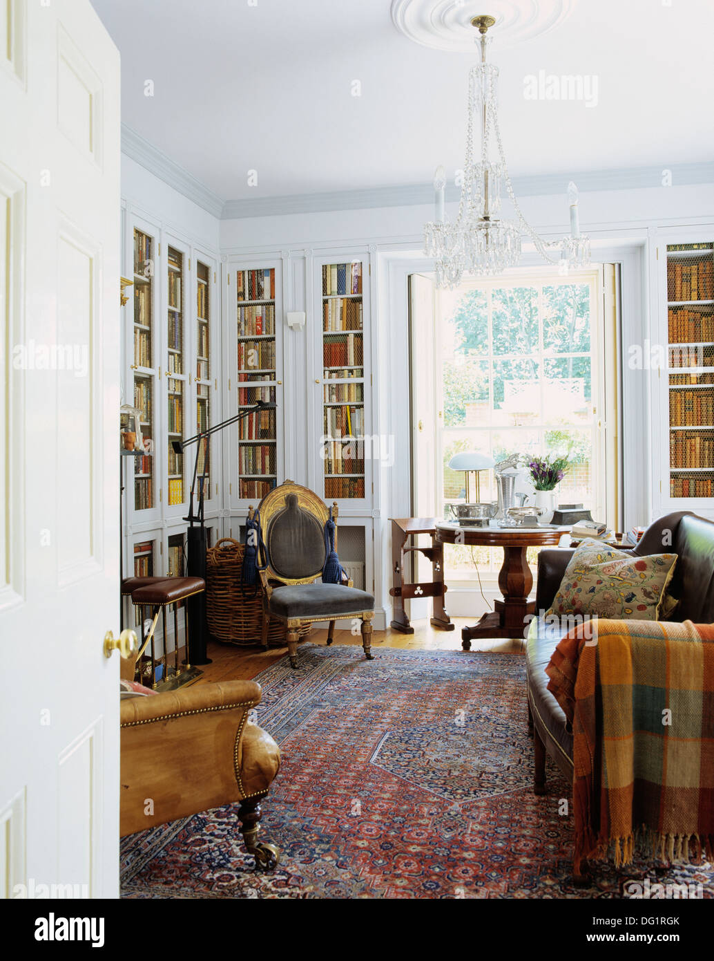 Green Traditional Living Room patterned rug and fitted bookcases in traditional living room with