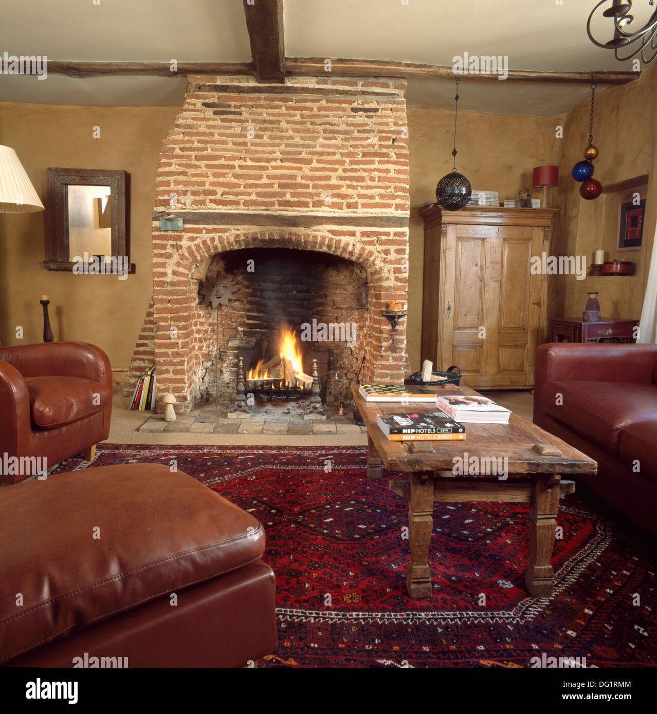 lighted fire in exposed brick fireplace in neutral country living
