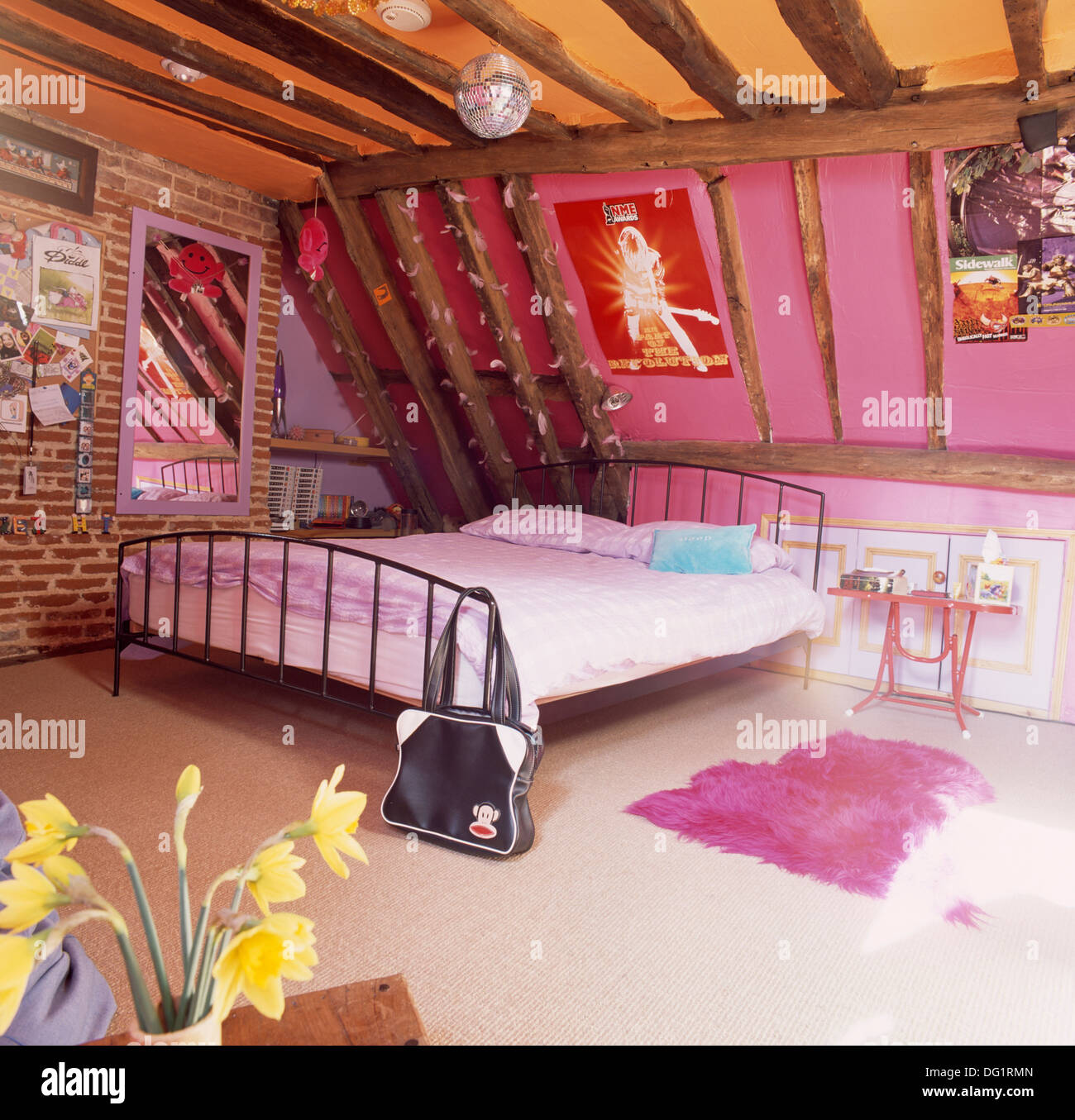 Faux Exposed Brick Mirror On Exposed Brick Wall Beside Large Metal Bed In Dated Pink